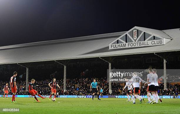 Matt Ritchie of Bournemouth scores their fourth goal from a fre kick during the Sky Bet Championship match between Fulham and AFC Bournemouth at...