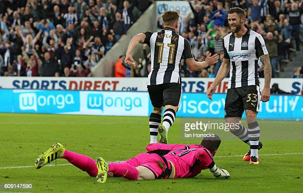Matt Ritchie of Newcastle celebrates scoring the first goal with teammate Daryl Murphy during the EFL Cup third round match between Newcastle United...