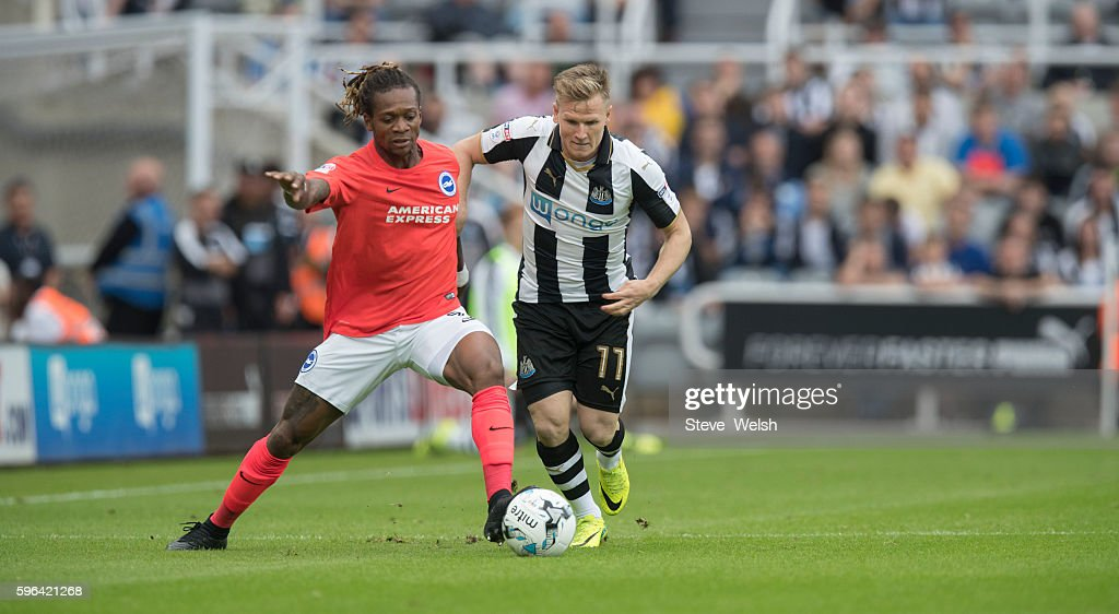 Matt Ritchie of Newcastle challenges Gaetan Bong of Brighton during the Premier League match between Newcastle United and Brighton & Hove Albion on August 27, 2016 in Newcastle.
