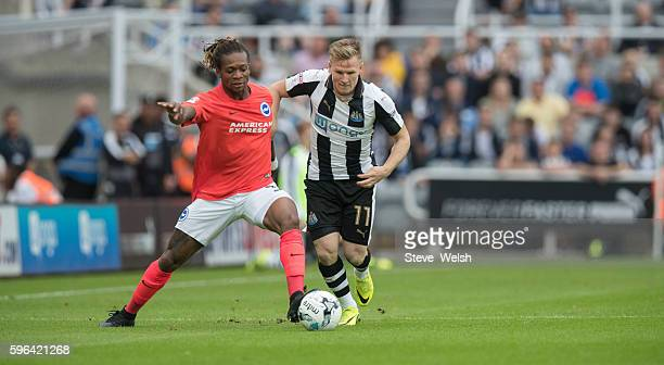 Matt Ritchie of Newcastle challenges Gaetan Bong of Brighton during the Premier League match between Newcastle United and Brighton Hove Albion on...