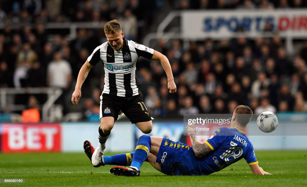 Matt Ritchie of Newcastle is tackled by Pontus Jansson of Leeds during the Sky Bet Championship match between Newcastle United and Leeds United at St James' Park on April 14, 2017 in Newcastle upon Tyne, England.