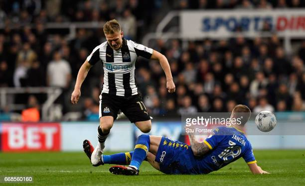 Matt Ritchie of Newcastle is tackled by Pontus Jansson of Leeds during the Sky Bet Championship match between Newcastle United and Leeds United at St...
