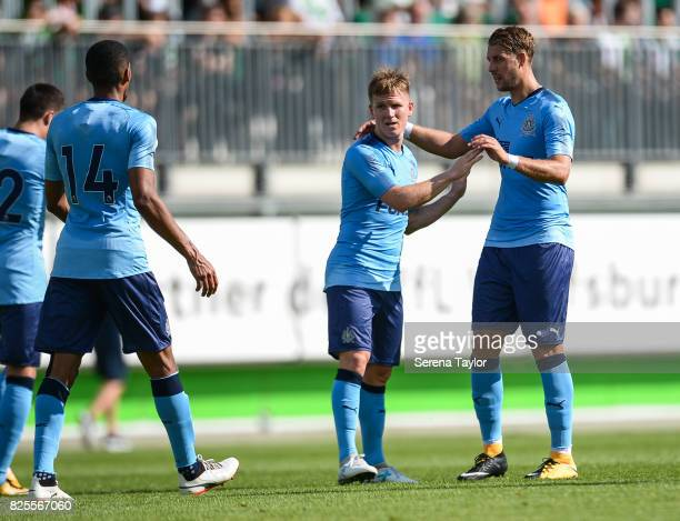 Matt Ritchie of Newcastle United celebrates with teammate Florian Lejeune after he scores the second goal from a free kick during the Pre Season...