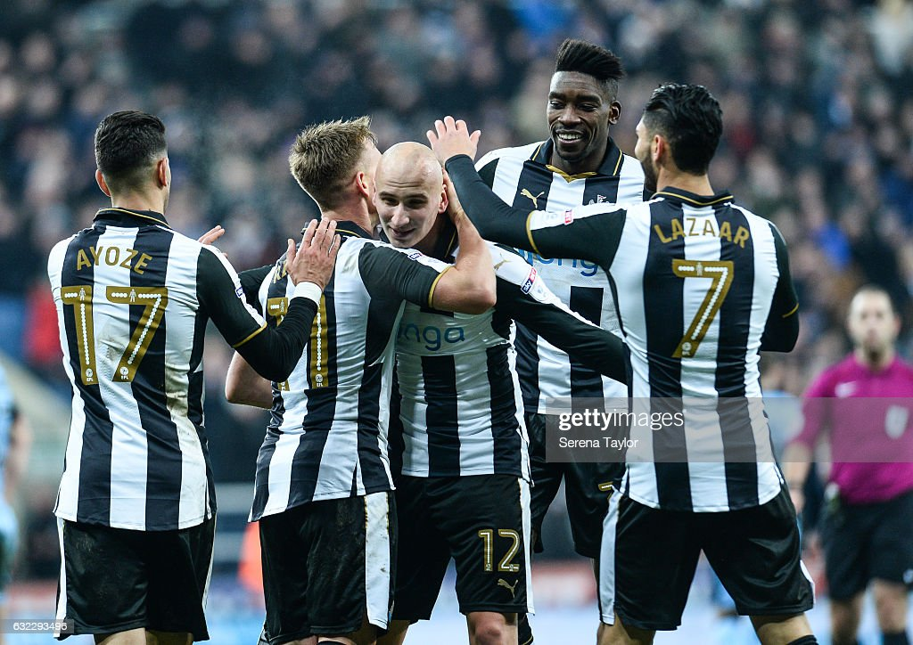 Matt Ritchie of Newcastle United (11) celebrates with teammate Jonjo Shelvey after scoring his second and Newcastle's fourth goal during the Sky Bet Championship match between Newcastle United and Rotherham United at St.James'Park on January 21, 2017 in Newcastle upon Tyne, England.
