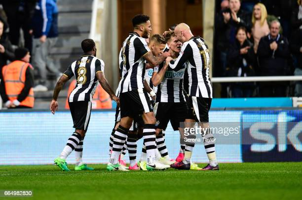 Matt Ritchie of Newcastle United celebrates with teammates after scoring the opening goal during the Sky Bet Championship Match between Newcastle...