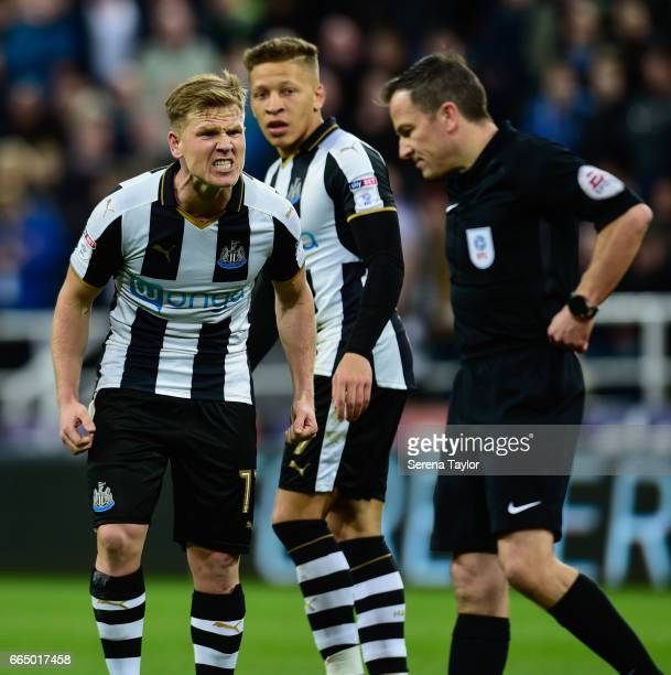 Matt Ritchie of Newcastle United gestures to Referee Keith Stroud during the Sky Bet Championship Match between Newcastle United and Burton Albion at...
