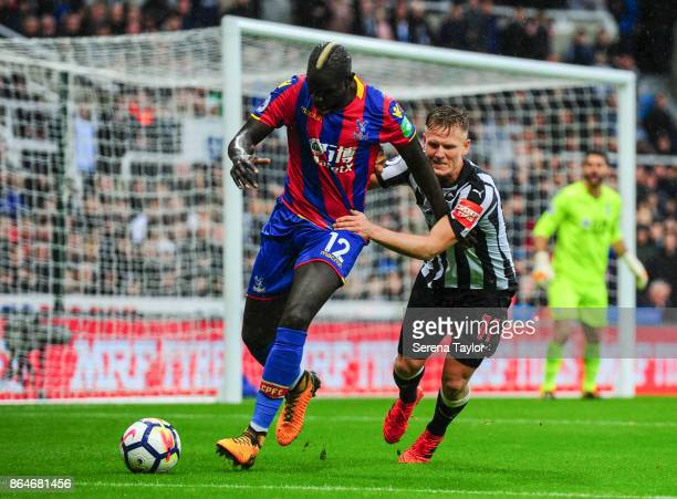 Matt Ritchie of Newcastle United grabs hold of Mamadou Sakho of Crystal Palace during the Premier League match between Newcastle United and Crystal...