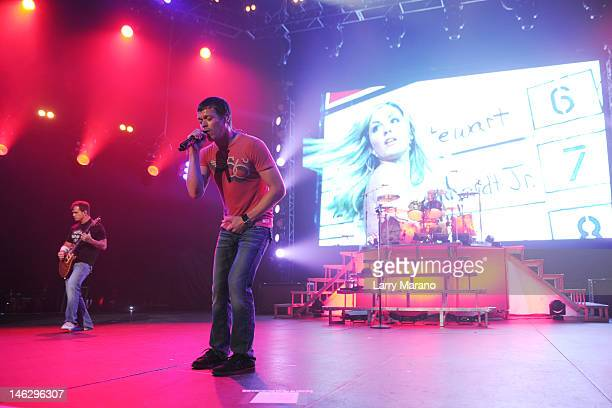 Matt Roberts Brad Arnold and Greg Upchurch of 3 Doors Down perform at Hard Rock Live in the Seminole Hard Rock Hotel Casino on June 12 2012 in...