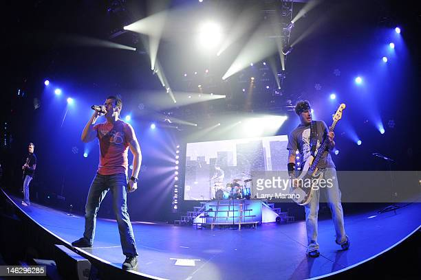 Matt Roberts Brad Arnold Greg Upchurch and Todd Harrell of 3 Doors Down perform at Hard Rock Live in the Seminole Hard Rock Hotel Casino on June 12...