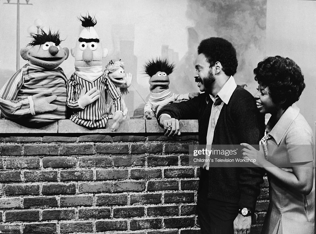 Matt Robinson and Loretta Long lean on a brick wall and speak with from left Muppets Ernie Bert an Anything Muppet and Roosevelt Franklin October 15...