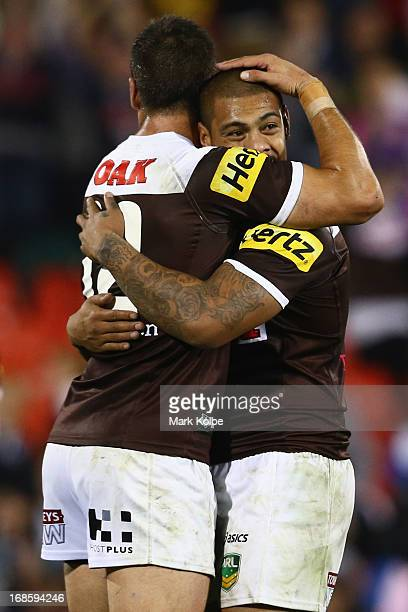 Matt Robinson and Sika Manu of the Panthers celebrate victory during the round nine NRL match between the Penrith Panthers and the Melbourne Storm at...