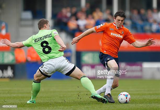Matt Robinson of Luton Town avoids the challenge of Yan Klukowski of Forest Green during the Skrill Conference Premier match between Luton Town and...