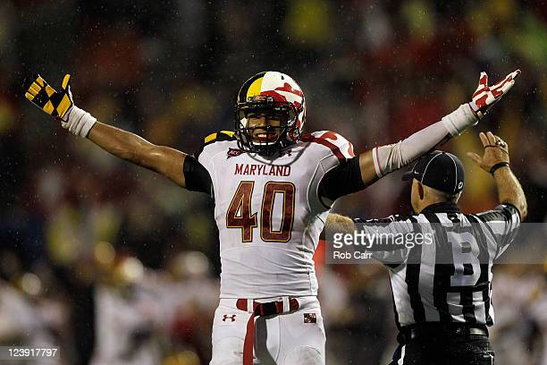 Matt Robinson of the Maryland Terrapins celebrates during the closing moments of the Terrapins 3224 win over the Miami Hurricanes at Byrd Stadium on...