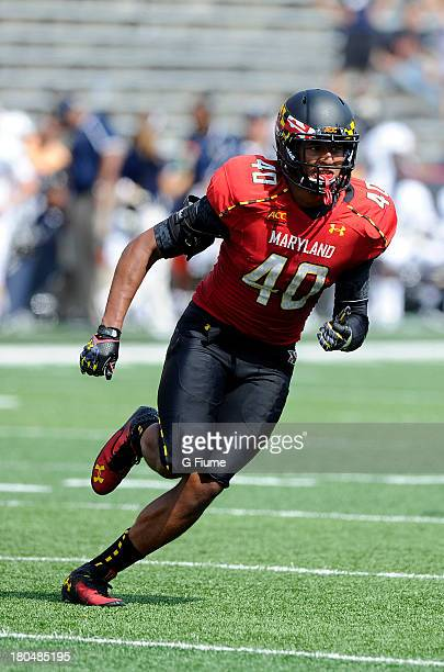 Matt Robinson of the Maryland Terrapins rushes off the line of scrimmage against the Florida International Golden Panthers at Byrd Stadium on August...