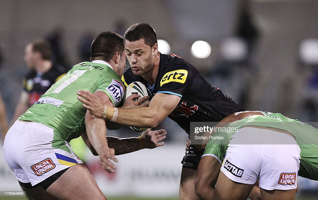 <a gi-track='captionPersonalityLinkClicked' href=/galleries/search?phrase=Matt+Robinson&family=editorial&specificpeople=4700604 ng-click='$event.stopPropagation()'>Matt Robinson</a> of the Panthers is tackled during the round 14 NRL match between the Canberra Raiders and the Penrtih Panthers at Canberra Stadium on June 15, 2013 in Canberra, Australia.