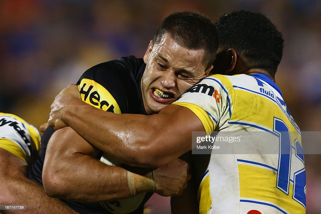 <a gi-track='captionPersonalityLinkClicked' href=/galleries/search?phrase=Matt+Robinson&family=editorial&specificpeople=4700604 ng-click='$event.stopPropagation()'>Matt Robinson</a> of the Panthers is tackled during the round seven NRL match between the Penrith Panthers and the Parramatta Eels at Centrebet Stadium on April 29, 2013 in Penrith, Australia.
