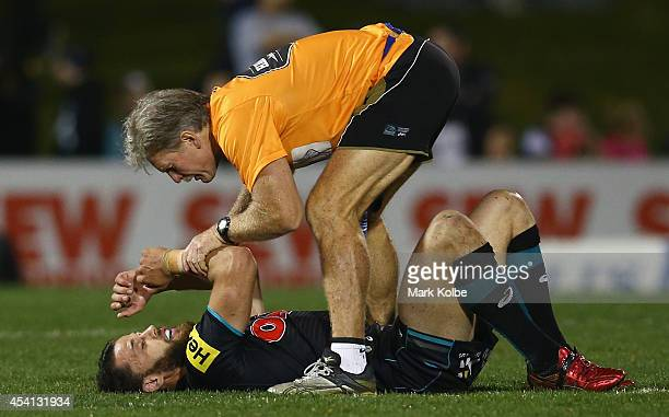 Matt Robinson of the Panthers receives medical attention during the round 24 NRL match between the Penrith Panthers and the Melbourne Storm at...