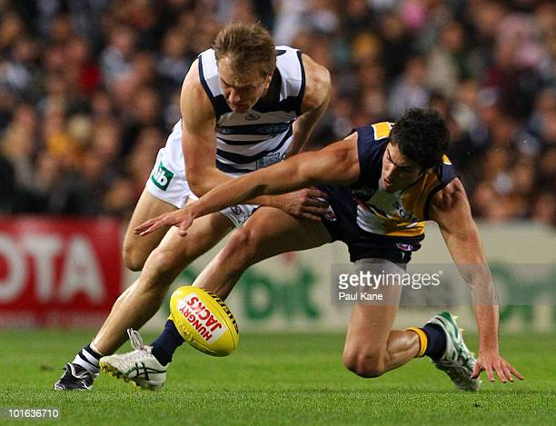 Matt Rosa of the Eagles and Darren Milburn of the Cats contest the ball during the round 11 AFL match between the West Coast Eagles and the Geelong...