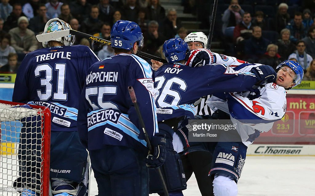 Matt Roy (L) of Hamburg fights with Michael Glumac (R) of Mannheim during the DEL match between Hamburg Freezers and Adler Mannheim at O2 World on January 18, 2013 in Hamburg, Germany.