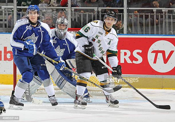Matt Rupert of the London Knights looks for a shot to tip next to Kyle Capobianco and Troy Timpano of the Sudbury Wolves in an OHL game at the...