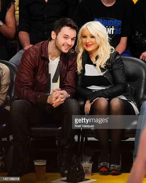 Matt Rutler and Christina Aguilera attend a basketball game between the Oklahoma City Thunder and the Los Angeles Lakers at Staples Center on March...