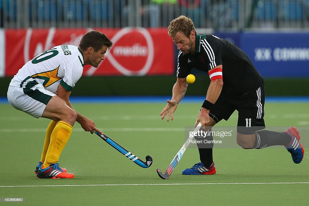 Matt Ruxton of Wales is challanged by Lloyd Norris-Jones of South Africa during the men's preliminaries match between Wales and South Africa at the Glasgow National Hockey Centre during day six of the Glasgow 2014 Commonwealth Games on July 29, 2014 in Glasgow, United Kingdom.