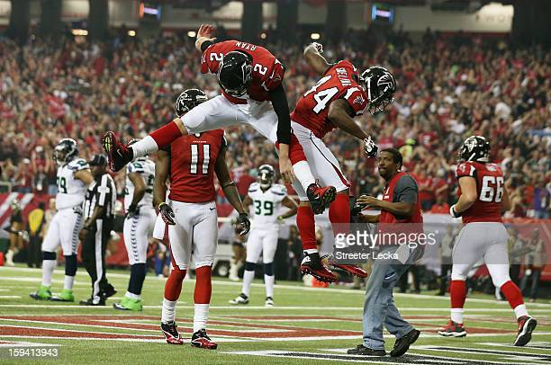 Matt Ryan and Jason Snelling of the Atlanta Falcons celebrate their third quarter touchdown against the Seattle Seahawks during the NFC Divisional...