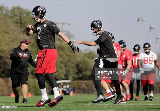 Matt Ryan of the Atlanta Falcons and Matt Schaub warm up before a Super Bowl LI practice on February 2 2017 in Houston Texas
