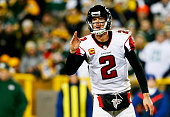 Matt Ryan of the Atlanta Falcons calls a play against the Green Bay Packers in the second half at Lambeau Field on December 8 2014 in Green Bay...