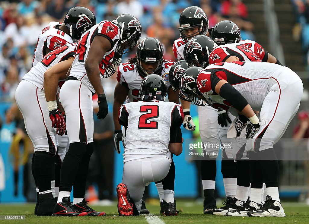 Matt Ryan #2 of the Atlanta Falcons calls a play in the huddle during their game against the Carolina Panthers at Bank of America Stadium on December 9, 2012 in Charlotte, North Carolina.