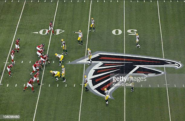 Matt Ryan of the Atlanta Falcons calls signals out of the shotgun formation against the Green Bay Packers defense during their 2011 NFC divisional...