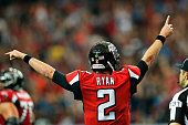 Matt Ryan of the Atlanta Falcons celebrates a touchdown during the second half against the Carolina Panthers at the Georgia Dome on December 27 2015...