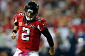 Matt Ryan of the Atlanta Falcons celebrates a touchdown in the second half against the Houston Texans at the Georgia Dome on October 4 2015 in...