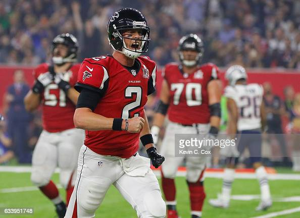 Matt Ryan of the Atlanta Falcons celebrates after Tevin Coleman scored a touchdown against the New England Patriots in the third quarter during Super...