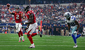 Matt Ryan of the Atlanta Falcons completes a touchdown pass to Julio Jones of the Atlanta Falcons against Barry Church of the Dallas Cowboys at ATT...