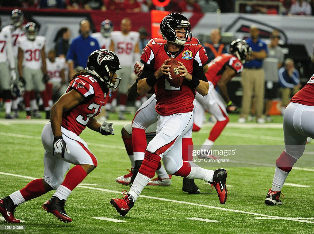 Matt Ryan #2 of the Atlanta Falcons drops back to pass against the New York Giants at the Georgia Dome on December 16, 2012 in Atlanta, Georgia