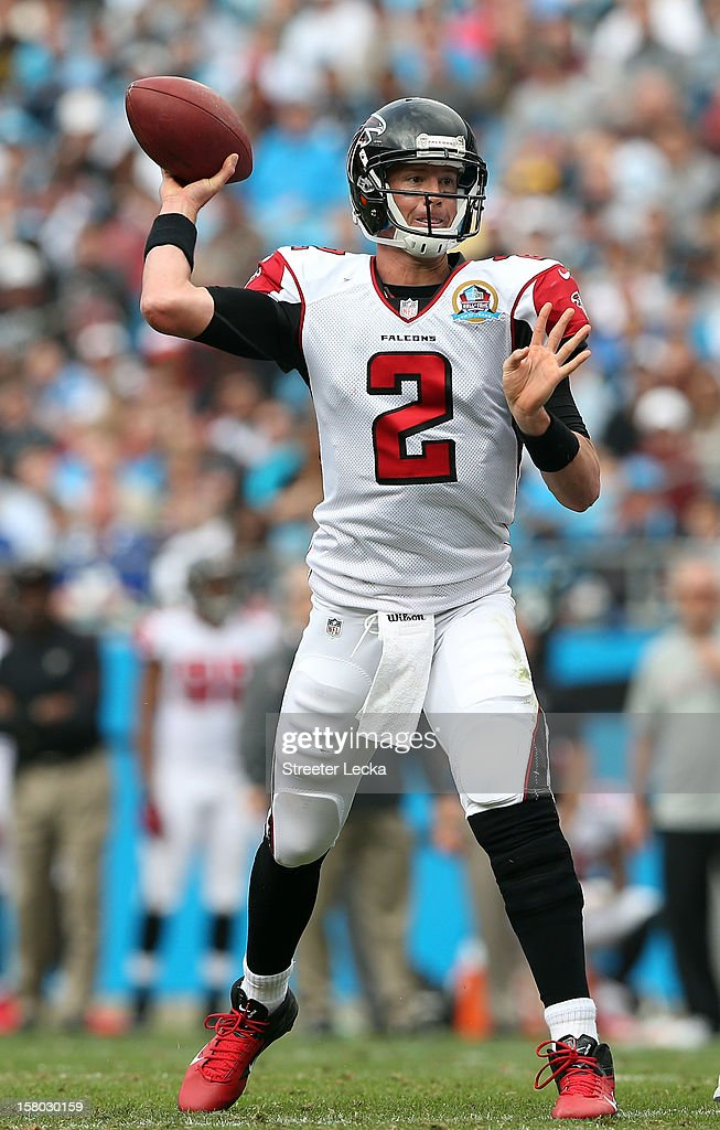 Matt Ryan #2 of the Atlanta Falcons drops back to pass during their game against the Carolina Panthers at Bank of America Stadium on December 9, 2012 in Charlotte, North Carolina.