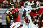 Matt Ryan of the Atlanta Falcons drops back to pass in the first half against the Carolina Panthers at the Georgia Dome on December 28 2014 in...