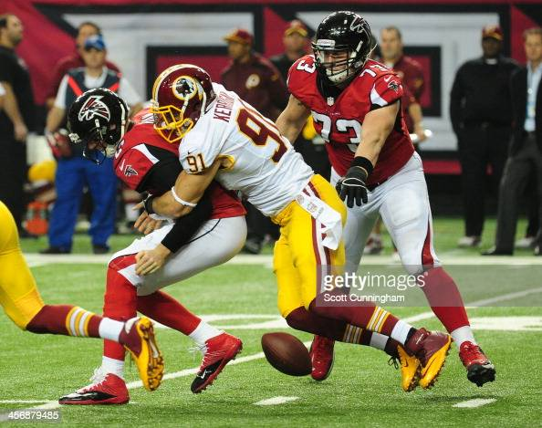 Matt Ryan of the Atlanta Falcons fumbles as he is hit by Ryan Kerrigan of the Washington Redskins at the Georgia Dome on December 15 2013 in Atlanta...