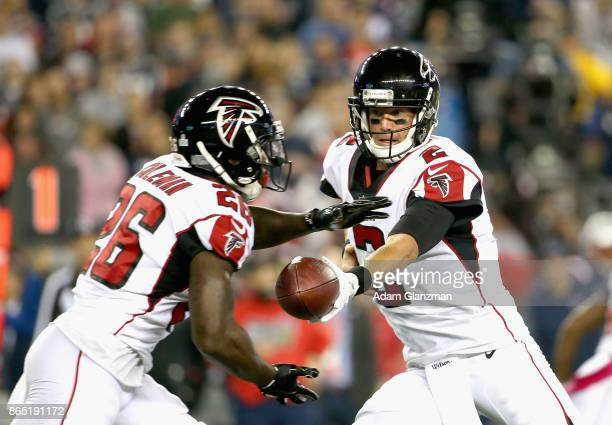 Matt Ryan of the Atlanta Falcons hands off the ball to Tevin Coleman during the first quarter of a game against the New England Patriots at Gillette...