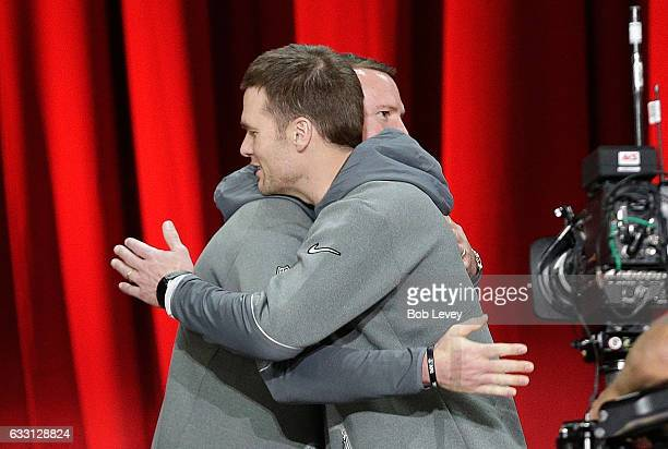 Matt Ryan of the Atlanta Falcons hugs Tom Brady of the New England Patriots during Super Bowl 51 Opening Night at Minute Maid Park on January 30 2017...