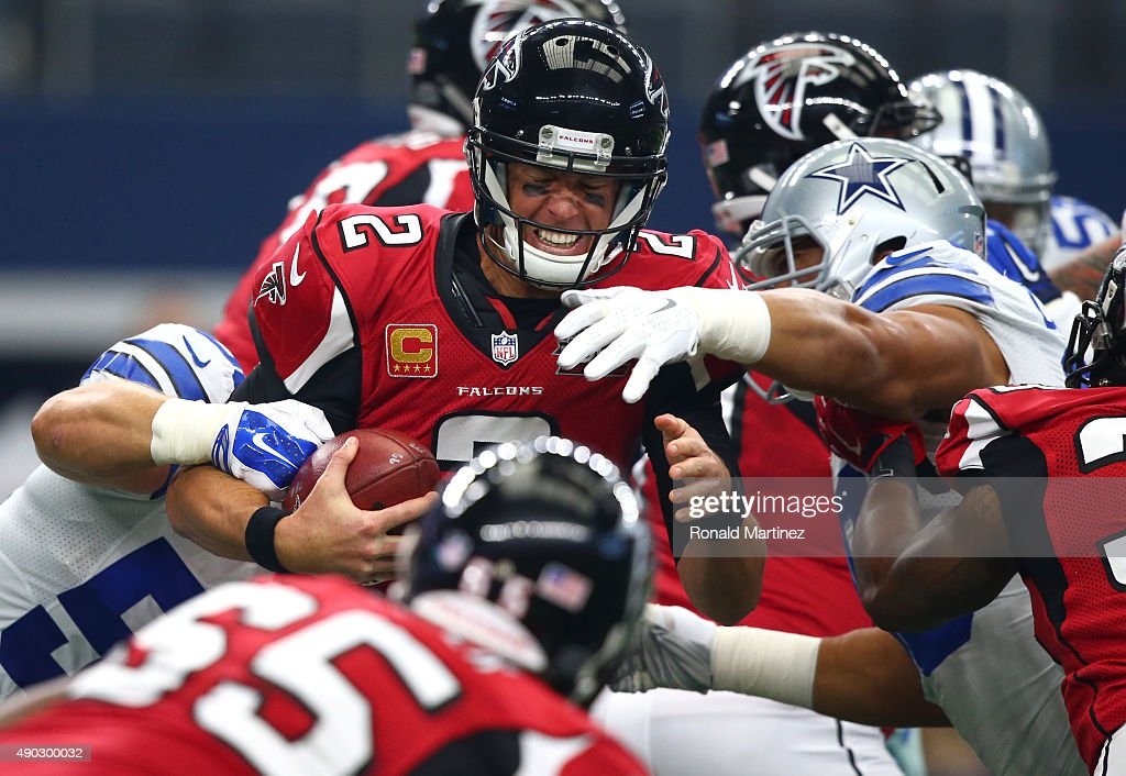 <a gi-track='captionPersonalityLinkClicked' href=/galleries/search?phrase=Matt+Ryan+-+American+footballer&family=editorial&specificpeople=4951318 ng-click='$event.stopPropagation()'>Matt Ryan</a> #2 of the Atlanta Falcons is sacked by Dallas Cowboys defenders in the first quarter at AT&T Stadium on September 27, 2015 in Arlington, Texas.