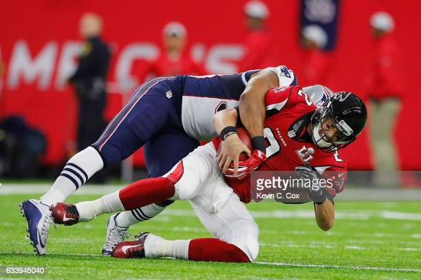 Matt Ryan of the Atlanta Falcons is sacked by Trey Flowers of the New England Patriots in the first quarter during Super Bowl 51 at NRG Stadium on...