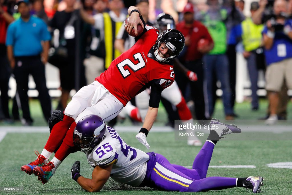 Matt Ryan #2 of the Atlanta Falcons is tackled by Anthony Barr #55 of the Minnesota Vikings during the second half at Mercedes-Benz Stadium on December 3, 2017 in Atlanta, Georgia.