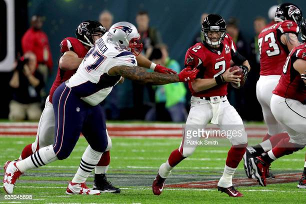 Matt Ryan of the Atlanta Falcons looks for a pass with pressure from Alan Branch of the New England Patriots during the first half of Super Bowl 51...