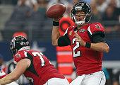 Matt Ryan of the Atlanta Falcons looks for an open receiver against the Dallas Cowboys at ATT Stadium on September 27 2015 in Arlington Texas