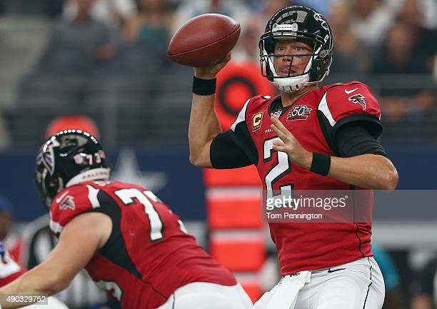 Matt Ryan of the Atlanta Falcons looks for an open receiver against the Dallas Cowboys at ATT Stadium on September 27 2015 in Arlington Texas