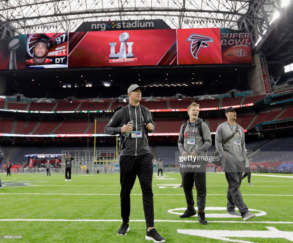 Matt Ryan #2 of the Atlanta Falcons, Matt Schaub #8, and Matt Simms#4 walk on the turf during the Super Bowl LI team walk through at NRG Stadium on February 4, 2017 in Houston, Texas.