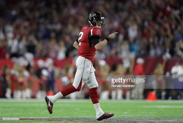Matt Ryan of the Atlanta Falcons reacts after a 5 yard touchdown run by Devonta Freeman in the second quarter against the New England Patriots during...