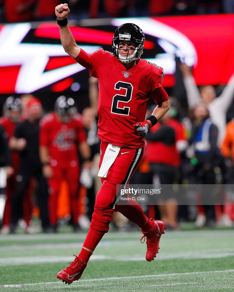 Matt Ryan #2 of the Atlanta Falcons reacts after Devonta Freeman #24 rushed for a touchdown against the New Orleans Saints at Mercedes-Benz Stadium on December 7, 2017 in Atlanta, Georgia.